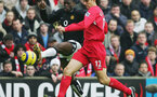 LIVERPOOL, ENGLAND - JANUARY 15:  Mauricio Pellegrino of Liverpool tackles Louis Saha of Manchester United the Barclays Premiership match between Liverpool and Manchester United at Anfield on January 15, 2004 in Manchester, England.  (Photo by Alex Livesey/Getty Images)