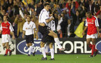 Football - UEFA Champions League - Valencia v Arsenal  - Quarter Final - 2nd Leg - 17/4/01  Valencia's Mauricio Pellegrino celebrates at the end with Miroslav Djukic as Arsenal's Fredrik Ljungberg and Thierry Henry walk off dejected  Mandatory Credit : Action Images/Alex Morton  Digital