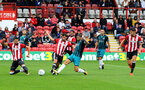 Charlie Austin shoots at goal  during the pre-season friendly between Brentford FC(red/white) and Southampton FC(black), at Griffin Park Stadium, Brentford, London, 22nd July 2017
