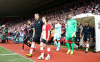 SOUTHAMPTON, ENGLAND - AUGUST 12: Steven Davis leads the teans out with the matchday mascots during the Premier League match between Southampton and Swansea City at St Mary's Stadium on August 12, 2017 in Southampton, England. (Photo by Matt Watson/Southampton FC via Getty Images)
