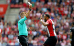 SOUTHAMPTON, ENGLAND - AUGUST 12: Southampton's Nathan Redmond is booked by referee Mike Jones during the Premier League match between Southampton and Swansea City at St Mary's Stadium on August 12, 2017 in Southampton, England. (Photo by Matt Watson/Southampton FC via Getty Images)