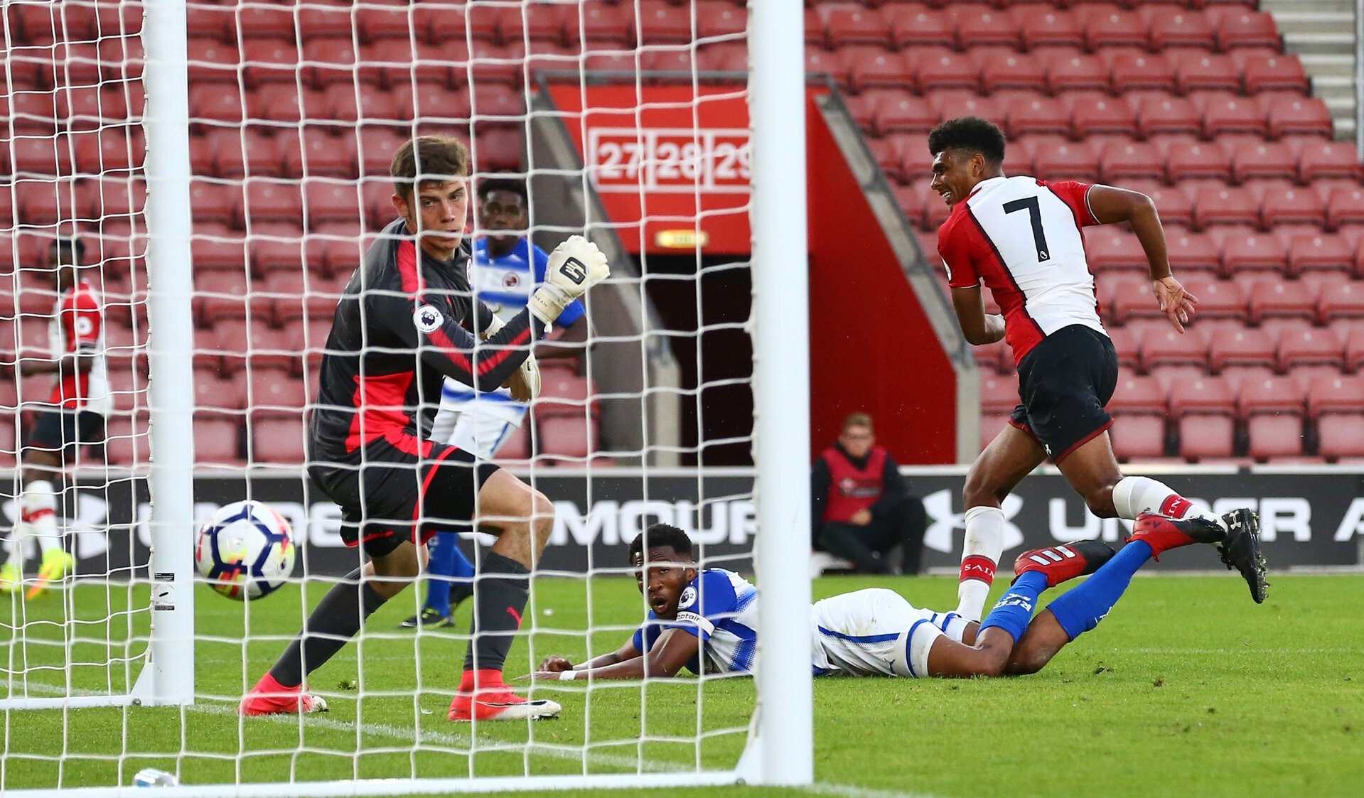 Marcus Barnes scores during the U23 Premier League 2 match between Southampton(red/white) and Reading, at St Mary's Stadium, 14th August 2017