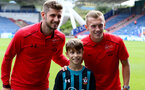 HUDDERSFIELD, ENGLAND - AUGUST 26: Southampton's Jack Stephen(left) and James Ward-Prowse meet the matchday mascot ahead of the Premier League match between Huddersfield Town and Southampton at the John Smith Stadium on August 26, 2017 in Huddersfield, England. (Photo by Matt Watson/Southampton FC via Getty Images)