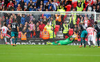 STOKE ON TRENT, ENGLAND - SEPTEMBER 30: Southampton keeper Fraser Forster saves Saido Berhino's penalty during the Premier League match between Stoke City and Southampton at the Bet365 Stadium on September 30, 2017 in Stoke on Trent, England. (Photo by Matt Watson/Southampton FC via Getty Images)