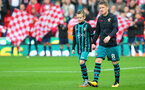STOKE ON TRENT, ENGLAND - SEPTEMBER 30: Southampton's Steven Davis leads the teams out with the matchday mascot during the Premier League match between Stoke City and Southampton at the Bet365 Stadium on September 30, 2017 in Stoke on Trent, England. (Photo by Matt Watson/Southampton FC via Getty Images)