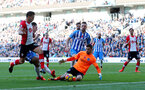 BRIGHTON, ENGLAND - OCTOBER 29: Southampton's Dusan Tadic(left) is denied by Brighton keeper Matthew Ryan during the Premier League match between Brighton and Hove Albion and Southampton at the Amex Stadium on October 29, 2017 in Brighton, England. (Photo by Matt Watson/Southampton FC via Getty Images)