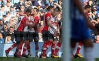 BRIGHTON, ENGLAND - OCTOBER 29: Southampton players celebrate with Steven Davis after he opens the scoring during the Premier League match between Brighton and Hove Albion and Southampton at the Amex Stadium on October 29, 2017 in Brighton, England. (Photo by Matt Watson/Southampton FC via Getty Images)