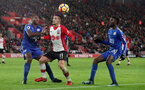 SOUTHAMPTON, ENGLAND - DECEMBER 13: Southampton's Dusan Tadic(centre) and Wes Morgan during the Premier League match between Southampton and Leicester City at St Mary's Stadium on December 13, 2017 in Southampton, England. (Photo by Matt Watson/Southampton FC via Getty Images)