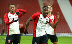 SOUTHAMPTON, ENGLAND - DECEMBER 14: LtoR Harlem Hale, Michael Obafemi, Will Smallbone of Southampton FC celebrate during the match between Southampton FC vs Wolverhampton Wanders for the FA U18's Youth Cup on December 14, 2017 in Southampton, England. (Photo by James Bridle - Southampton FC/Southampton FC via Getty Images)
