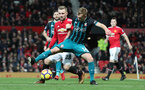 MANCHESTER, ENGLAND - DECEMBER 30: Southampton's James Ward-Prowse(R) under pressure from Luke Shaw during the Premier League match between Manchester United and Southampton at Old Trafford on December 30, 2017 in Manchester, England. (Photo by Matt Watson/Southampton FC via Getty Images)