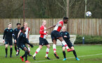 SOUTHAMPTON, ENGLAND - JANUARY 06:  Jonathan Afolabi (right) scores from a header during the PL2 match between Southampton FC and West Ham United FC at Staplewood Complex on January 6, 2018 in Southampton, England. (Photo by James Bridle - Southampton FC/Southampton FC via Getty Images)