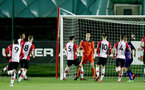 Kinglsey Latham is congratulated after saving a penalty during the U23 PL Cup between Southampton and Cardiff City, pictured at the Staplewood Campus, Southampton, 9th February 2018