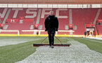 Southampton FC groundsman John Wright clears snowfall on the pitch, at St Mary's stadium, Southampton, 1st March 2018
