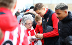SOUTHAMPTON, ENGLAND - MARCH 03: Jan Bednarek of Southampton FC signing fan merchandise ahead of the Premier League match between Southampton and Stoke City at St Mary's Stadium on March 3, 2018 in Southampton, England. (Photo by James Bridle - Southampton FC/Southampton FC via Getty Images)