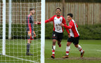 SOUTHAMPTON, ENGLAND - MARCH 17: Enzo Robise (middle) scores during the U18's match between Southampton FC and Reading FC at Staplewood Complex on March 16, 2018 in Southampton, England. (Photo by James Bridle - Southampton FC/Southampton FC via Getty Images)