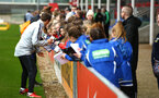BURTON ON TRENT, ENGLAND - APRIL 03: Phil Neville (left) signs fan autographs during the Southampton FC U16 girls visit to England's Training ground at St Georges Park on April 03, 2018 in Burton on Trent, England. (Photo by James Bridle - Southampton FC/Southampton FC via Getty Images)