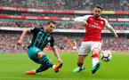 LONDON, ENGLAND - APRIL 08: Cedric(L) of Southampton beats Sead Kolasinac(R) of Arsenal to cross during the Premier League match between Arsenal and Southampton at Emirates Stadium on April 8, 2018 in London, England. (Photo by Matt Watson/Southampton FC via Getty Images)