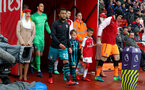 LONDON, ENGLAND - APRIL 08: Ryan Bertrand of Southampton leads the teams out with the matchday mascot during the Premier League match between Arsenal and Southampton at Emirates Stadium on April 8, 2018 in London, England. (Photo by Matt Watson/Southampton FC via Getty Images)