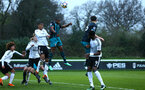 SOUTHAMPTON, ENGLAND - APRIL 13: Michael Obafemi goes for the header (middle) during the PL2 Match between Fulham FC and Southampton FC on April 12, 2018 in Fulham London, England. (Photo by James Bridle - Southampton FC/Southampton FC via Getty Images)