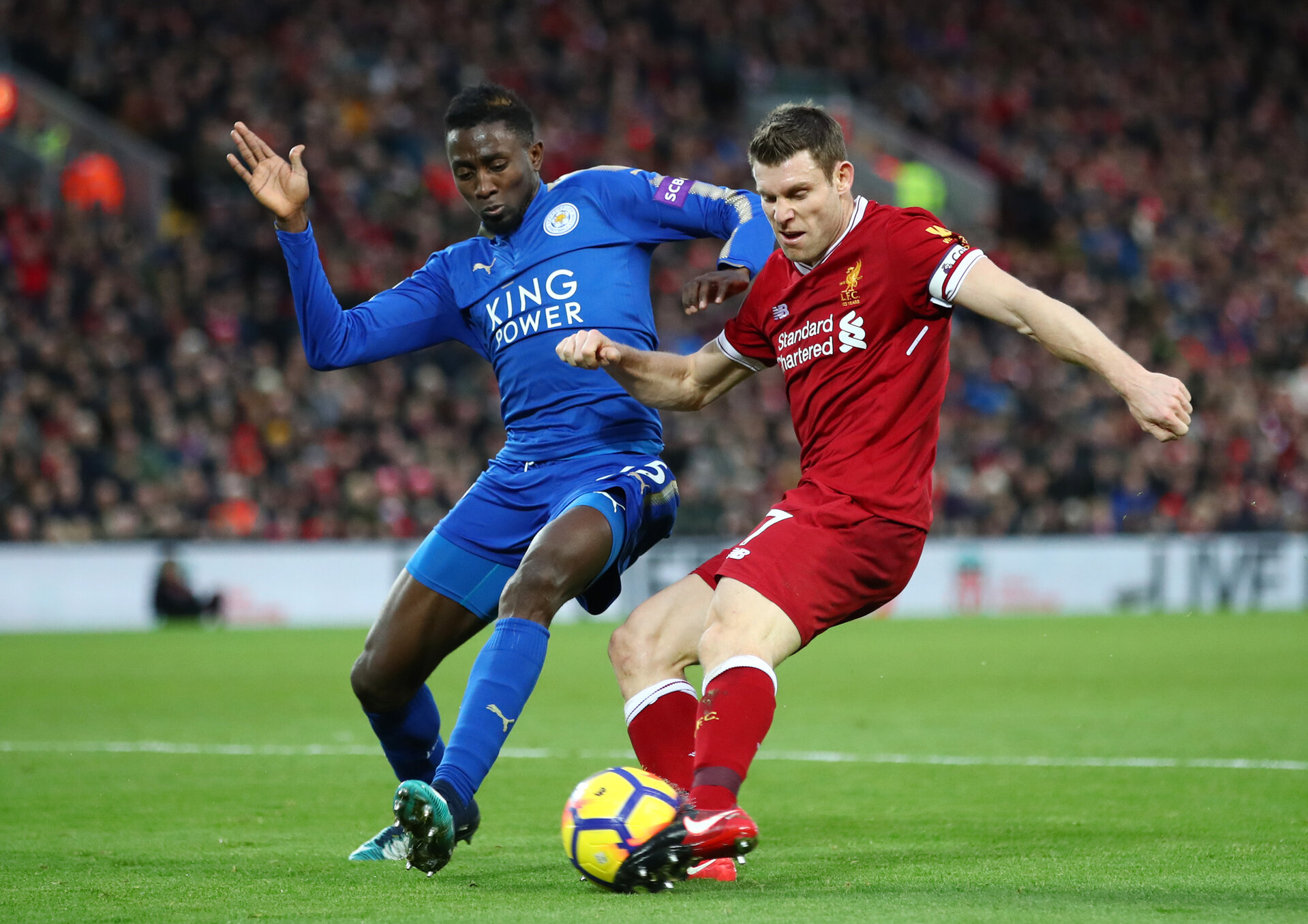 LIVERPOOL, ENGLAND - DECEMBER 30:  James Milner of Liverpool is closed down by Wilfred Ndidi of Leicester City during the Premier League match between Liverpool and Leicester City at Anfield on December 30, 2017 in Liverpool, England.  (Photo by Clive Brunskill/Getty Images)