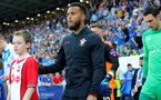 LEICESTER, ENGLAND - APRIL 19: Ryan Bertrand of Southampton with the matchday mascot during the Premier League match between Leicester City and Southampton at The King Power Stadium on April 19, 2018 in Leicester, England. (Photo by Matt Watson/Southampton FC via Getty Images)