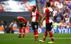 LONDON, ENGLAND - APRIL 22: Nathan Redmond of Southampton FC (middle) resets to the centre circle after Chelsea FC score during the Semi Final of the Emirates FA Cup between Southampton FC and Chelsea FC at Wembley Stadium on April 22, 2018 in London, England. (Photo by James Bridle - Southampton FC/Southampton FC via Getty Images)