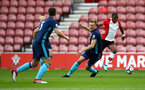 SOUTHAMPTON, ENGLAND - APRIL 23: Michael Obafemi (right) during the PL2 match between Southampton FC and Middlesbrough FC atSt Mary's Stadium on April 23, 2018 in Southampton, England. (Photo by James Bridle - Southampton FC/Southampton FC via Getty Images)