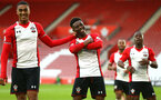SOUTHAMPTON, ENGLAND - APRIL 23: Nathan Tella (middle) scores for Southampton FC during the PL2 match between Southampton FC and Middlesbrough FC atSt Mary's Stadium on April 23, 2018 in Southampton, England. (Photo by James Bridle - Southampton FC/Southampton FC via Getty Images)