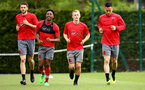 SOUTHAMPTON, ENGLAND - APRIL 24: LtoR Wesley Hoedt, Kanye Ramsay, James Ward-Prowse, Maya Yoshida during an open training session with Southampton FC at Staplewood Complex on April 24, 2018 in Southampton, England. (Photo by James Bridle - Southampton FC/Southampton FC via Getty Images)