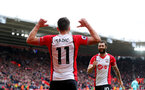 SOUTHAMPTON, ENGLAND - APRIL 28: Dusan Tadic(L) ans Charlie Austin(R) of Southampton celebrate after Dusan Tadic puts Southampton 1-0 up during the Premier League match between Southampton and AFC Bournemouth at St Mary's Stadium on April 28, 2018 in Southampton, England. (Photo by Matt Watson/Southampton FC via Getty Images)