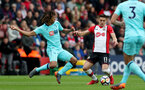 SOUTHAMPTON, ENGLAND - APRIL 28: Dusan Tadic(R) of Southampton and Nathan Ake of Bournemouth during the Premier League match between Southampton and AFC Bournemouth at St Mary's Stadium on April 28, 2018 in Southampton, England. (Photo by Matt Watson/Southampton FC via Getty Images)