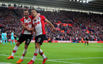 SOUTHAMPTON, ENGLAND - APRIL 28: Cedric(L) and Dusan Tadic(R) of Southampton celebrate during the Premier League match between Southampton and AFC Bournemouth at St Mary's Stadium on April 28, 2018 in Southampton, England. (Photo by Matt Watson/Southampton FC via Getty Images)