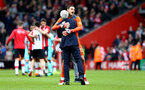 SOUTHAMPTON, ENGLAND - APRIL 28: Mark Hughes hugs Alex McCarthy after the final whistle is blown the Premier League match between Southampton and AFC Bournemouth at St Mary's Stadium on April 28, 2018 in Southampton, England. (Photo by James Bridle - Southampton FC/Southampton FC via Getty Images)