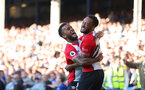 LIVERPOOL, ENGLAND - MAY 05: Nathan Redmond(R) of Southampton celebrates with team mate Ryan Bertrand(L) after putting his team 1-0 up during the Premier League match between Everton and Southampton at Goodison Park on May 5, 2018 in Liverpool, England. (Photo by Matt Watson/Southampton FC via Getty Images)