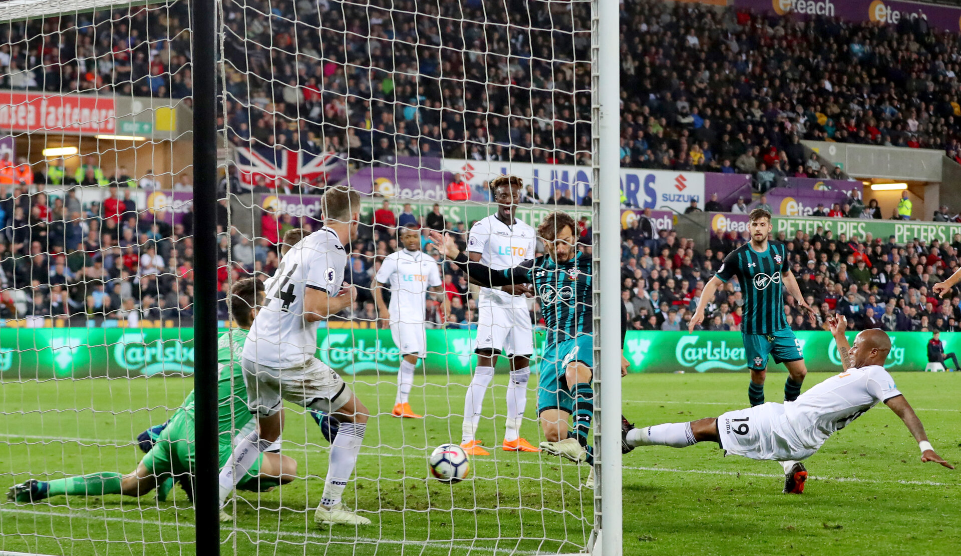 SWANSEA, WALES - MAY 08: Manolo Gabbiadini of Southampton scores during the Premier League match between Swansea City and Southampton at Liberty Stadium on May 8, 2018 in Swansea, Wales. (Photo by Matt Watson/Southampton FC via Getty Images)