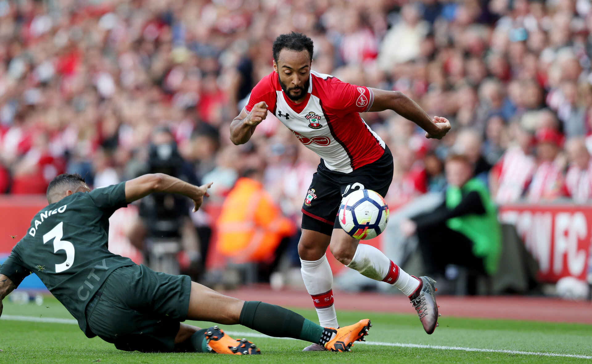 SOUTHAMPTON, ENGLAND - MAY 13: Nathan Redmond(R) of Southampton skips past Danilo of Manchester City during the Premier League match between Southampton and Manchester City at St Mary's Stadium on May 13, 2018 in Southampton, England. (Photo by Matt Watson/Southampton FC via Getty Images)