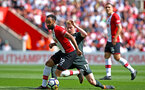SOUTHAMPTON, ENGLAND - MAY 13: Nathan Redmond (left) during the Premier League match between Southampton and Manchester City at St Mary's Stadium on May 13, 2018 in Southampton, England. (Photo by James Bridle - Southampton FC/Southampton FC via Getty Images)