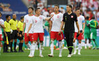 MOSCOW, RUSSIA - JUNE 19:  Dawid Kownacki, Piotr Zielinski, Jan Bednarek, Wojciech Szczesny, and Robert Lewandowski of Poland look dejected following their sides defeat in the 2018 FIFA World Cup Russia group H match between Poland and Senegal at Spartak Stadium on June 19, 2018 in Moscow, Russia.  (Photo by Shaun Botterill/Getty Images)