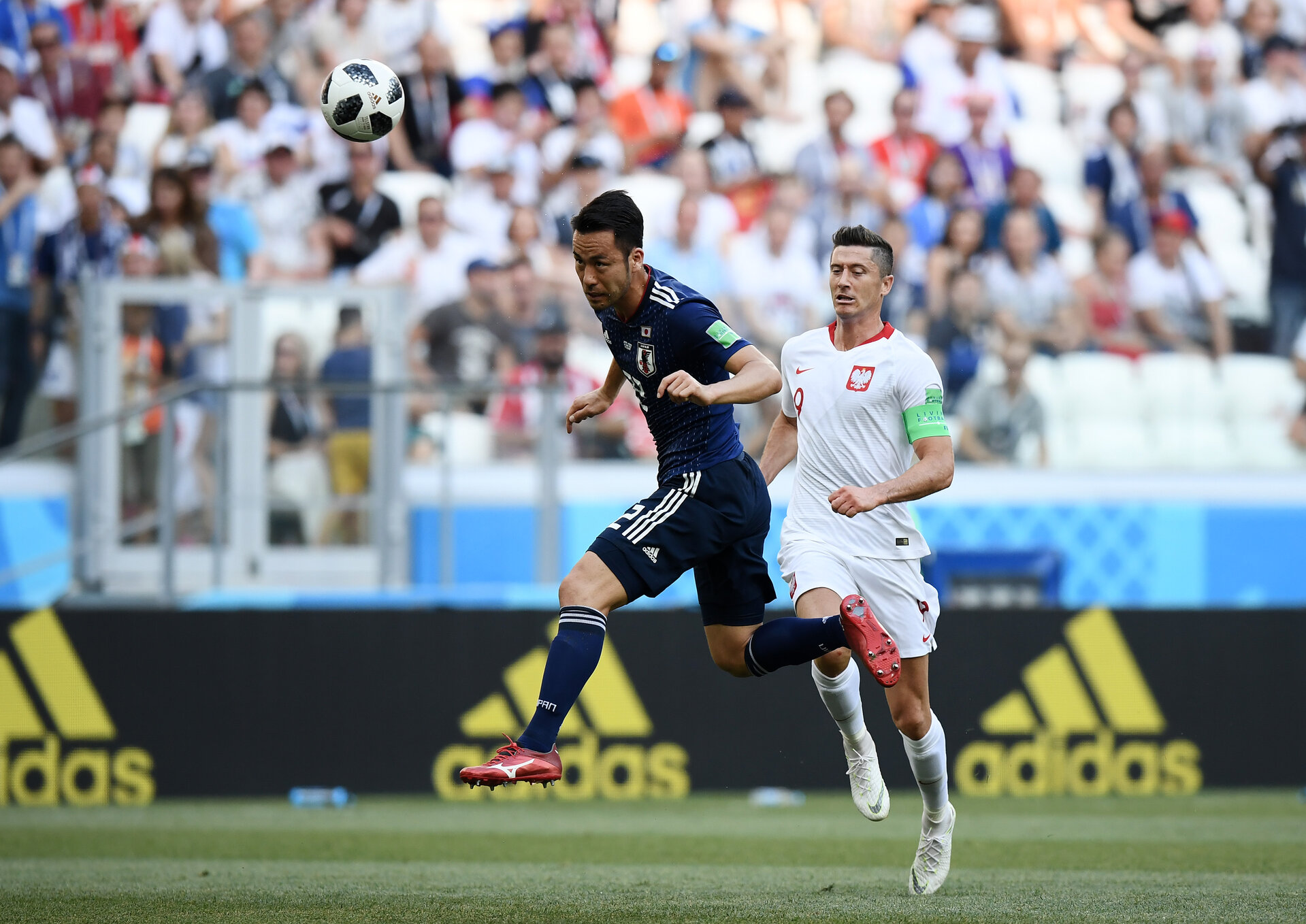 VOLGOGRAD, RUSSIA - JUNE 28:  Naomichi Ueda of Japan heads the ball to Eiji Kawashima (not pictured) during the 2018 FIFA World Cup Russia group H match between Japan and Poland at Volgograd Arena on June 28, 2018 in Volgograd, Russia.  (Photo by Carl Court/Getty Images)