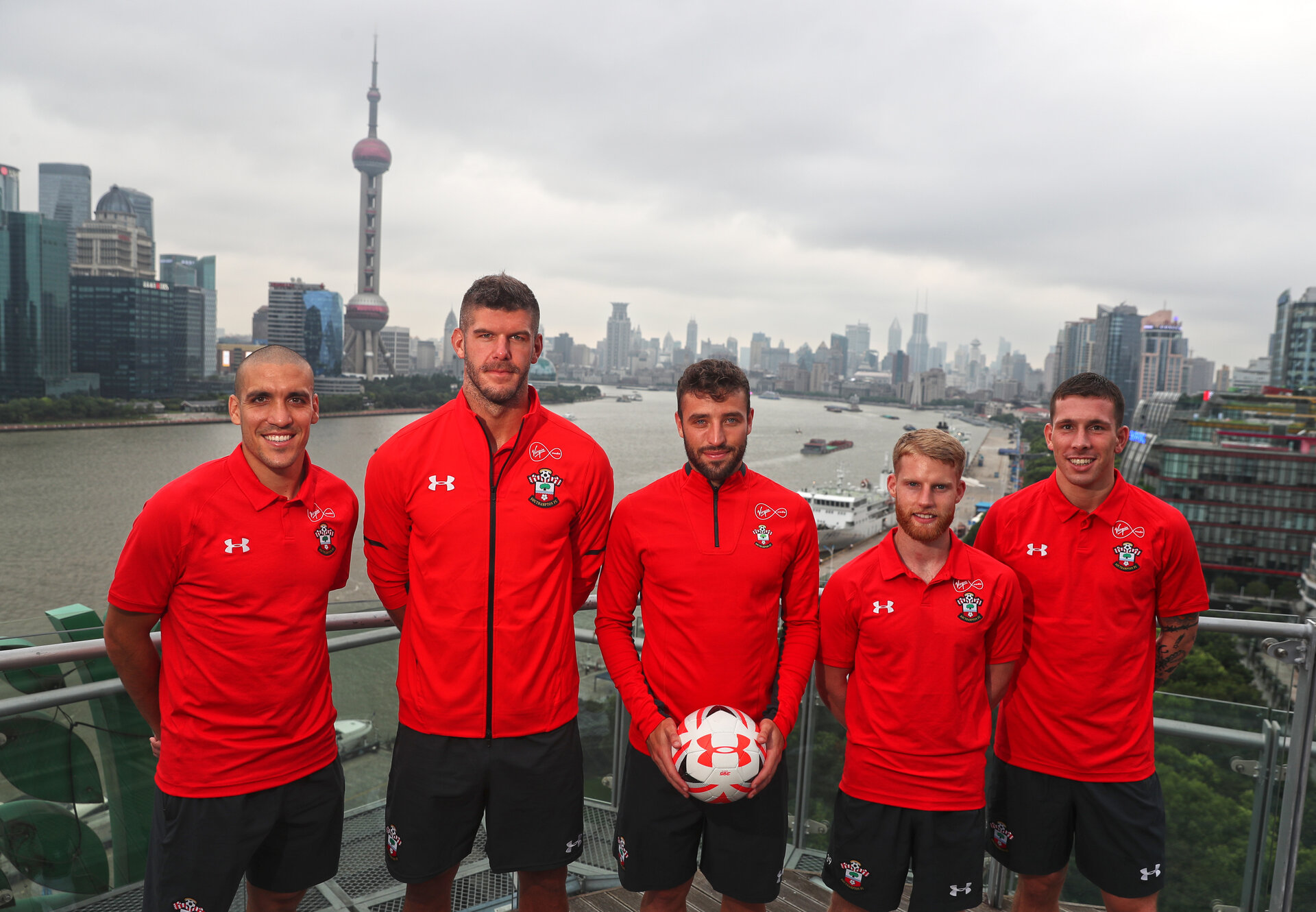 SHANGHAI, CHINA - JULY 06: L to R, Oriol Romeu, Fraser Forster, Sam McQueen, Josh Sims and Pierre-Emile Hojbjerg pictured on a rooftop terrace as Southampton FC players visit Shanghai centre while on their pre season tour of China, on July 6, 2018 in Shanghai, China. (Photo by Matt Watson/Southampton FC via Getty Images)