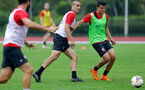 SHANGHAI, CHINA - JULY 10: Oriol Romeu(L) amd Mohamed Elyounoussi during a Southampton FC training session, while on their pre season tour of China, on July 10, 2018 in Xuzhou, China. (Photo by Matt Watson/Southampton FC via Getty Images)