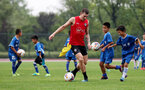 SHANGHAI, CHINA - JULY 09: Pierre-Emile Hojbjerg as a local youth team joins in with Southampton players during a Southampton FC training session, while on their pre season tour of China, on July 9, 2018 in Xuzhou, China. (Photo by Matt Watson/Southampton FC via Getty Images)