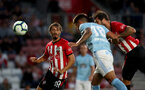 SOUTHAMPTON, ENGLAND - AUGUST 01: Charlie Austin(R) heads at goal as Manolo Gabbiaidini looks on during the pre-season friendly match between Southampton and Celta Vigo at St Mary's Stadium on August 1, 2018 in Southampton, England. (Photo by Matt Watson/Southampton FC via Getty Images)