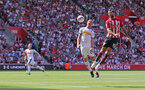 SOUTHAMPTON, ENGLAND - AUGUST 04: Charlie Austin(R) of Southampton out jumps Tony Jantschke during the pre-season friendly match between Southampton and Borussia Monchengladbach at St Mary's Stadium on August 4, 2018 in Southampton, England. (Photo by Matt Watson/Southampton FC via Getty Images)