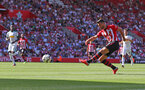 SOUTHAMPTON, ENGLAND - AUGUST 04: Shane Long of Southampton shoots at goal during the pre-season friendly match between Southampton and Borussia Monchengladbach at St Mary's Stadium on August 4, 2018 in Southampton, England. (Photo by Matt Watson/Southampton FC via Getty Images)
