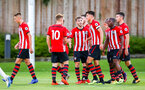 SOUTHAMPTON, ENGLAND - AUGUST 10: Alfie Jones scores (middle) and team mates celebrate around him during the PL2 match between Southampton FC vs Middlesbrough FC pictured at Staplewood Complex on August 10, 2018 in Southampton, England. (Photo by James Bridle - Southampton FC/Southampton FC via Getty Images)