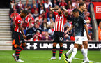 SOUTHAMPTON, ENGLAND - AUGUST 12: a near miss for Charlie Austin (middle) during the Premier League match between Southampton FC and Burnley FC at St Mary's Stadium on August 12, 2018 in Southampton, United Kingdom. (Photo by James Bridle - Southampton FC/Southampton FC via Getty Images)