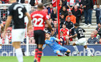 SOUTHAMPTON, ENGLAND - AUGUST 12: Alex McCarthy of Southampton denies Aaron Lennon during the Premier League match between Southampton FC and Burnley FC at St Mary's Stadium on August 12, 2018 in Southampton, United Kingdom. (Photo by Matt Watson/Southampton FC via Getty Images)