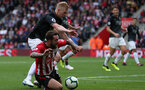 SOUTHAMPTON, ENGLAND - AUGUST 12: Danny Ings of Southampton, and Ben Mee (in black) of Burnley during the Premier League match between Southampton FC and Burnley FC at St Mary's Stadium on August 12, 2018 in Southampton, United Kingdom. (Photo by Chris Moorhouse/Southampton FC via Getty Images)