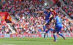 SOUTHAMPTON, ENGLAND - AUGUST 25: Shane Long(R) of Southampton jumps with Harry Maguire of Leicester during the Premier League match between Southampton FC and Leicester City at St Mary's Stadium on August 25, 2018 in Southampton, United Kingdom. (Photo by Matt Watson/Southampton FC via Getty Images)